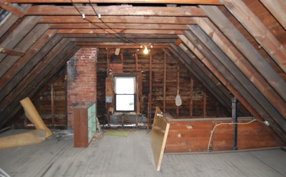 Who legally owns the Attic Space in Scottish Tenements?